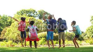 Group of kids jumping together in park