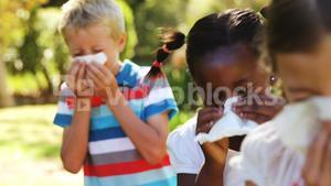Kids blowing their nose with handkerchief while sneezing