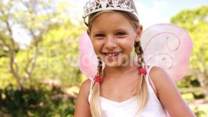 Young girl pretending to be a fairy