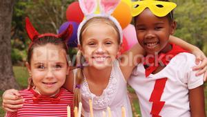 Kids in various costumes celebrating birthday