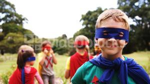 Group of kids pretending to be a super hero