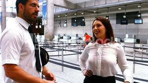 Pilot and female flight attendant interacting with each other