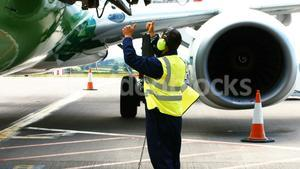 Aircraft marshaller giving direction