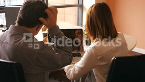 Business people using digital tablet and laptop