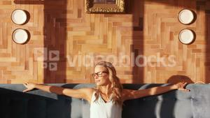 Blond woman relaxing on sofa