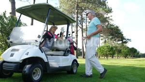 Male golf player interacting with woman