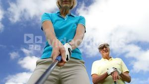 Golf players playing together
