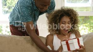 Man giving a surprise gift to his woman