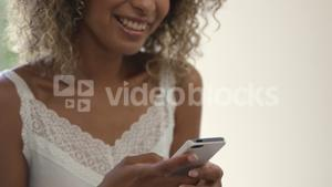 Young woman text messaging on phone