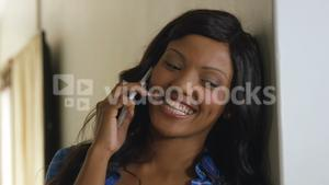 Happy woman talking on the mobile phone