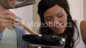 Young couple cooking food together in kitchen