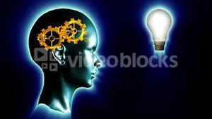 Human head with gears and cogs and a lightbulb. Concept of thinking a brilliant idea