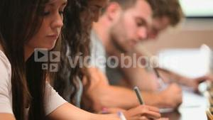 Close up of students writing