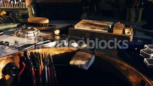 Goldsmith work tools on workbench