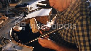Goldsmith preparing work tool