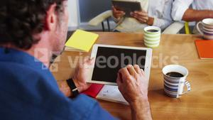 Business executives using digital tablet