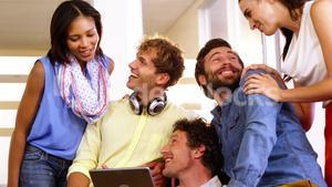 Businesspeople enjoying together in office