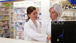 Pharmacists maintaining a record of medicine on computer