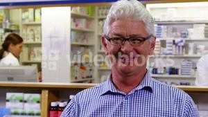 Customer holding prescription while checking medicine in pharmacy