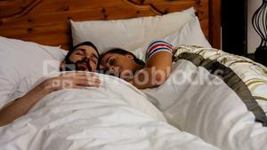 Couple sleeping together on bed