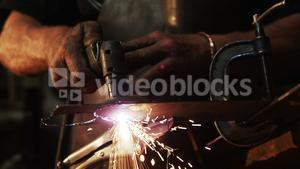 Mid-section of welder using welding torch