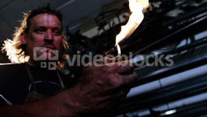 Welder burning welding torch with a lighter