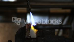 Close-up of welder using welding torch