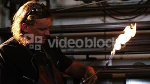 Welder burning welding torch