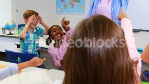 School kids irritating teacher in classroom