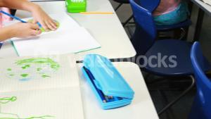 Kids drawing in classroom