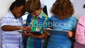 School kids using digital tablet in classroom