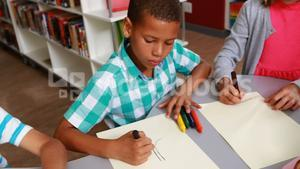 Kids drawing in library