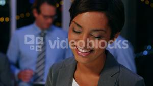 Portrait of business executive smiling in office