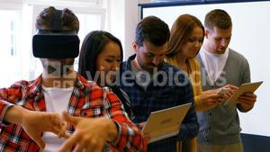 Business executives using digital tablet, mobile phone and virtual reality headsets