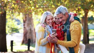 Parents and son taking a selfie on mobile phone