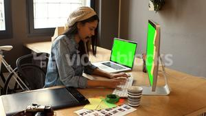 Female graphic designer working on computer