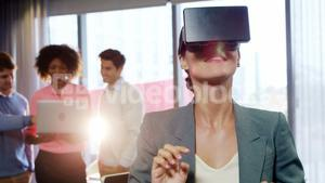 Businesswoman using the virtual reality headset