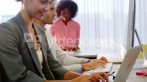 Businesswoman working on laptop at desk