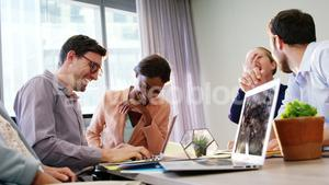Businesspeople having fun while working
