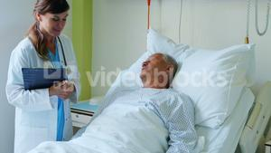Female doctor interacting with patient