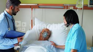 Doctor and nurse interacting with patient