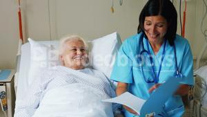 Female doctor discussing report with senior patient