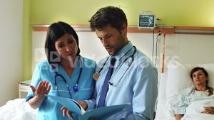 Doctors discussing on report