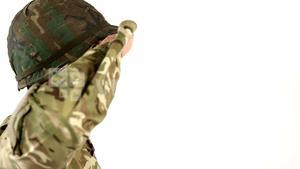 Soldier saluting on white background