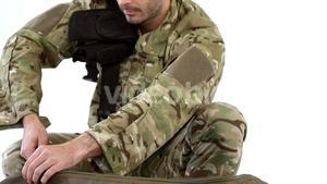 Soldier packing bag on white background