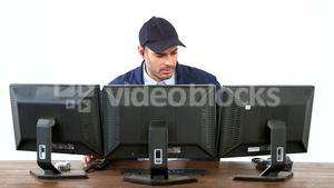 Security guard watching cctv footage on computer