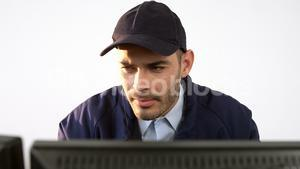 Security guard working on computer