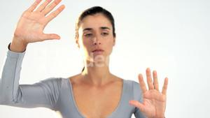 Woman gesturing on white background