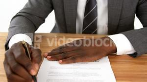 Businessman filling a insurance form