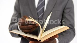 Businessman flipping pages of a book